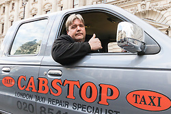 Whitehall, London, February 10th 2016. The owner of a taxi garage joins his endangered customers as an estimated 8,000 cabbies hold a go-slow in protest against what they say is unfair competition from minicab and Uber drivers who do not have to undergo the rigorous training and checks required for the licenced taxi trade. ///FOR LICENCING CONTACT: paul@pauldaveycreative.co.uk TEL:+44 (0) 7966 016 296 or +44 (0) 20 8969 6875. ©2015 Paul R Davey. All rights reserved.