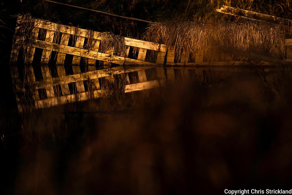 Oxnam, Jedburgh, Scottish Borders, UK. 18th November 2018. Reflections on a still Oxnam Water.