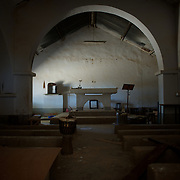 January 21, 2013 - Diabaly, Mali: General view of the inside of a destroyed catholic church in central Diabaly, a day after Mali government troops regain control of the city. Diabaly was under islamist militants control since the 14th of January.<br /> <br /> Several insurgent groups have been fighting a campaign against the Malian government for independence or greater autonomy for northern Mali, an area known as Azawad. The National Movement for the Liberation of Azawad (MNLA), an organisation fighting to make Azawad an independent homeland for the Tuareg people, had taken control of the region by April 2012.<br /> <br /> The Malian government pledge to the French army to help the national troops to stop the rebellion advance towards the capital Bamako. The french troops started aerial attacks on rebel positions in the centre of the country and deployed several hundred special forces men to counter attack the advance on the ground. (Paulo Nunes dos Santos)