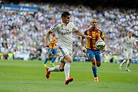 Real Madrid´s James Rodriguez and Valencia´s Sofiane Feghouli during 2014-15 La Liga match between Real Madrid and Valencia at Santiago Bernabeu stadium in Madrid, Spain. May 09, 2015. (ALTERPHOTOS/Luis Fernandez)