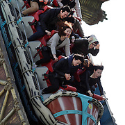 Thrill seekers ride on the attractions at Lotte World. Lotte World is the world's largest indoor theme park which includes shopping malls, a luxury hotel, and an Ice rink. Opened on July 12, 1989, Lotte World receives over 8 million visitors each year. Seoul, South Korea. 21st March 2012. Photo Tim Clayton
