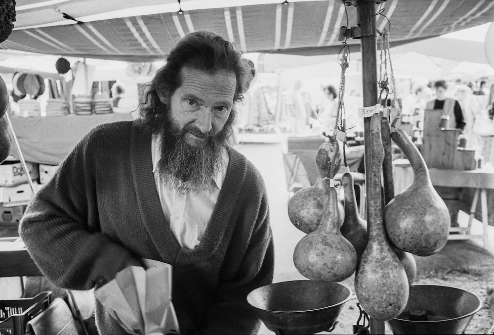 A farmer at his stall, selling gourds and other things, at the open market in Lasalle, a town in the Cévennes in the Gard dfepartement in the south of France.
