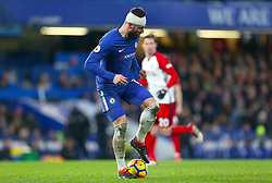 Chelsea's Olivier Giroud in action with a bandage on his head