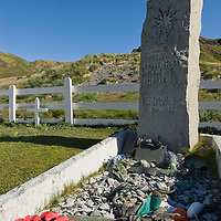 Offerings from around the world lie below the headstone of Sir Ernest Shackleton in the cemetary at Grytviken,  South Georgia, Antarctica.