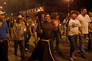 """Headed by Fray Tomás González, director of shelter """"La 72"""", central american migrants walk during the night  in Tenosique in a protest into the Nationa Migratory institute  local facilities during the """"Viacrucis migrante""""  on April 6th, 2012.  (Photo: Prometeo Lucero)"""