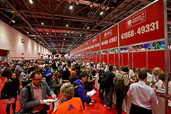 © Licensed to London News Pictures.22/04/2015<br /> LONDON UK: Keen runners collect their numbers on the opening  day of registration of the 2015 Virgin Money London Marathon at the Excel Centre London.Photo credit : Andrew Baker/LNP