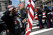 Member of the Patriot Guard Riders holding a US flag while standing in front of the Bedsford Central Presbyterian church, during the passage of LCpl. Nicholas J. Whyteís coffin, in Brooklyn, New York, NY., on Friday, June 30, 2006. LCpl. Nicholas J. Whyte, a 21-year-old American serviceman died  on June 21, 2006, while conducting combat operations in Al Anbar province, Iraq. The Patriot Guard Riders is a diverse amalgamation of riders from across the United States of America. Besides a passion for motorcycling, they all have in common an unwavering respect for those who risk their lives for the country's freedom and security. They are an American patriotic group, mainly but not only, composed by veterans from all over the United States. They work in unison, calling upon tens of different motorcycle groups, connected by an internet-based web where each of them can find out where and when a 'Mission' is called upon, and have the chance to take part. This way, the Patriot Guard Riders can cover the whole of the United States without having to ride from town to town but, by organising into different State Groups, each with its own State Captain, they are still able to maintain strictly firm guidelines, and to honour the same basic principles that moves the group from the its inception. The main aim of the Patriot Guard Riders is to attend the funeral services of fallen American servicemen, defined as 'Heroes' by the group,  as invited guests of the family. These so-called 'Missions' they undertake have two basic objectives in particular: to show their sincere respect for the US 'Fallen Heroes', their families, and their communities, and to shield the mourners from interruptions created by any group of protestors. Additionally the Patriot Guard Riders provide support to the veteran community and their families, in collaboration with the other veteran service organizations already working in the field.   **ITALY OUT**