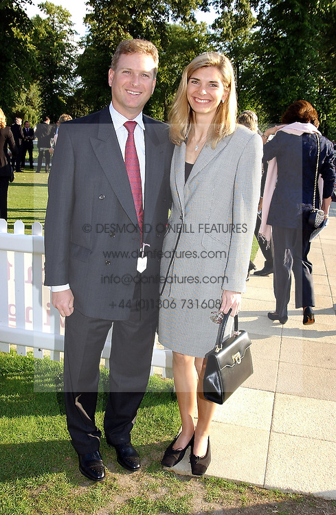 WILLIAM & LUCY ASPREY at the Royal Windsor Charity Race Evening in aid of the Great Ormond Street Hospital Children's Charity held at Windsor Racecourse, Berkshire on 5th July 2004.