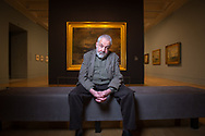 Film Director, Mike Leigh, in front of a JMW Turner painting in the Tate Britain museum, London, Britain. <br /> Photo©Steve Forrest/Workers' Photos
