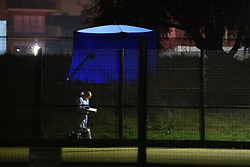 © Licensed to London News Pictures. 19/09/2021. London, UK. A forensic investigator, with a forensic tent in the background, gathers evidence in Cator Park on Kidbrooke Park Road in Greenwich following a call at 17:32BST on Saturday 18/09/2021 to the body of a female found near the community centre. A man was arrested several hours later at approximately 21:20BST at an address in Lewisham on suspicion of murder and was taken into custody at a south London police station. Photo credit: Peter Manning/LNP