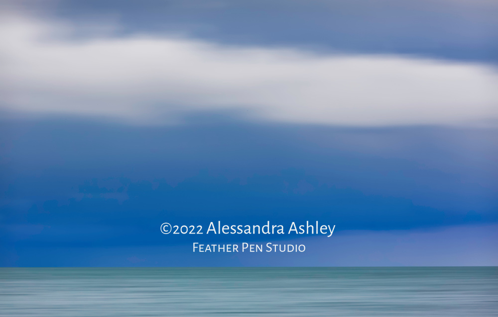 Bold colors of foreboding skies over Lake Erie as a storm approaches. Captured with in-camera pan blur effect. Photographed adjacent to Magee Marsh Wildlife Area.