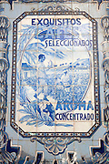 Antique advertisement using blue and white ceramic tiles to advertise coffee from the tropics, Seville, Spain