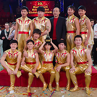 Members of the Quingdao Troupe of China celebrate winning the Golden Pierrot award during the 10th International Circus Festival in Budapest, Hungary on January 13, 2014. ATTILA VOLGYI