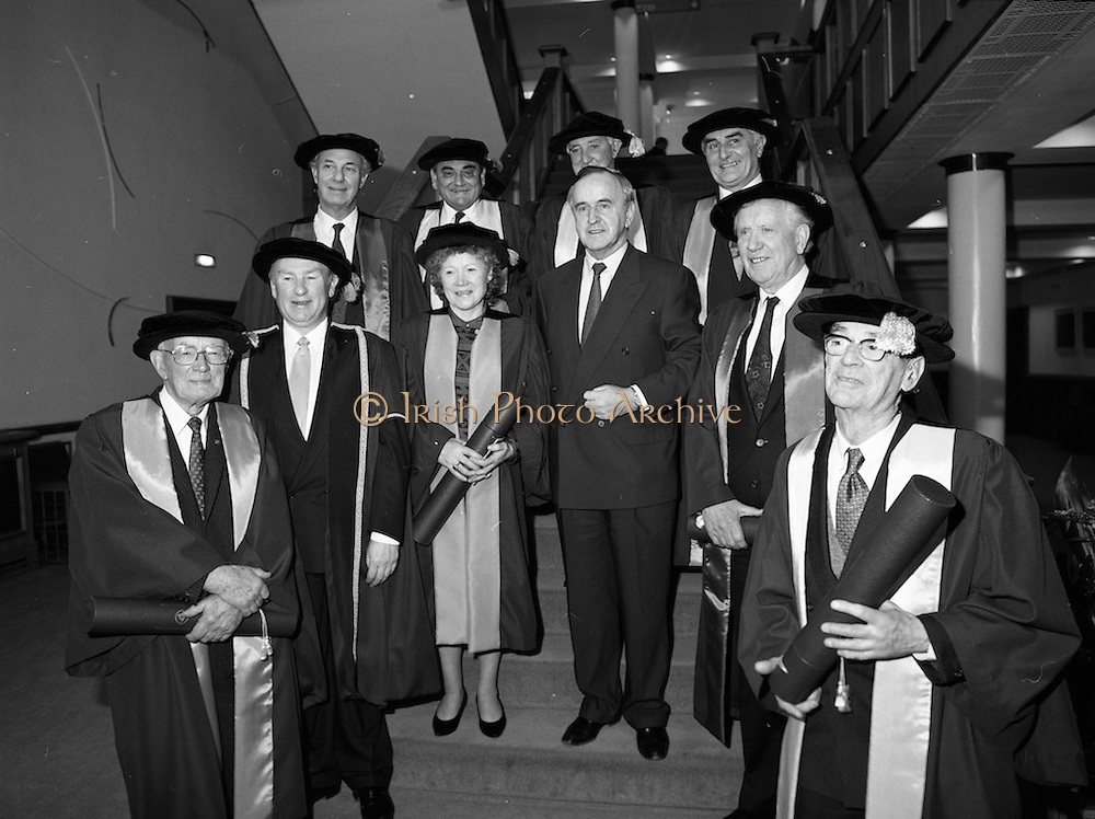 30/11/1992<br /> 11/30/1992<br /> 30 November 1992<br /> Conferring of Honorary Degrees (LL.D.) by the National Council for Educational Awards in Dublin Castle Conference Centre, Dublin. Picture shows Taoiseach Albert Reynolds, T.D. centre with the conferees: Front row: Mr. Kevin Killeen and Mr J.C. Nagle. Second row: Unknown; Mrs. Angela Collins O'Mahony; The Taoiseach and Mr. Padraig Faulkner. Back row: Mr. Hywel Jones; Mr. Padraig MacDiarmada; Mr. Patrick Donegan and Mr. J.G. Corr.