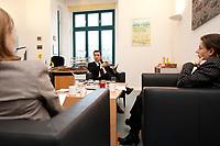 05 JAN 2012, BERLIN/GERMANY:<br /> Ulrike Sosalla, Redakteurin FTD, Cem Oezdemir, B90/Gruene Bundesvorsitzender, Frederike von Tiesenhausen, Redakteurin FTD, (v.L.n.R.), waerhend einem Interview, in Buero von Oezdemir, Bundesgeschaeftsstelle Buendnis 90 / Die Gruenen<br /> IMAGE: 20120105-01-042<br /> KEYWORDS: Cem Özdemir, Büro