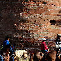072114  Adron Gardner/Independent<br /> <br /> A group of horseback riders carrousel around the Navajo Nation Tribal Council chambers for the start of the summer session of the Navajo Nation Tribal Council in Window Rock Monday.