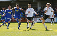 Photo: Steve Bond/Richard Lane Photography. Hereford United v Leicester City. Coca Cola League One. 11/04/2009. Steve Howard (2nd L) gets a shot in as Richard Rose (R) tries to block