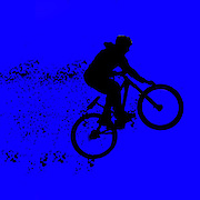 Digitally enhanced image of a bicycle stunt