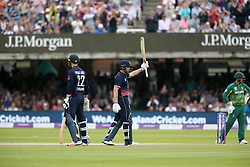 England's Jonny Bairstow celebrates his 50th run during the One Day International at Lord's, London.