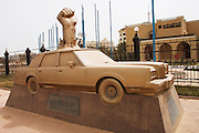 Monument to Sheikh Fahad Al-Sabah on Arabian Gulf Street. The plaque below says that Sheikh Fahad Al-Sabah was assassinated by the Iraqi invading troops in this car on Thursday the 2nd of August, 1990, while defending his country and principles. (Supporting image from the project Hungry Planet: What the World Eats.).