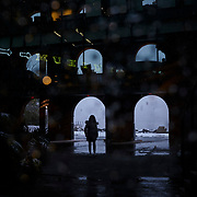 A woman watches as the snow falls in Dumbo, Brooklyn, New York on Thursday November 15, 2018. John Taggart for The New York Times
