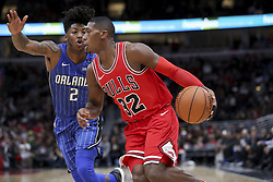 December 20, 2017 - Chicago, IL, USA - Thee Chicago Bulls' Kris Dunn (32) drives past the Orlando Magic's Elfrid Payton (2) during the first half at the United Center in Chicago on Wednesday, Dec. 20, 2017. The Bulls won, 112-94. (Credit Image: © Armando L. Sanchez/TNS via ZUMA Wire)