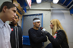 An injured Abbas Suan doing an interview for a local TV station, Jaffa, Israel, Jan. 29, 2006. <br />Abbas was ejected from a game with his local team Bnei Sahknin when a foul was called on him at Bloomfield Stadium. One his assistant coaches commented that they are never sure the injuries Abbas sustains during matches are unintentional. His team has a mixture of Israeli-Arab, Israeli, and foreign players. Suan, an Israeli-Arab, still faces criticism and racism resulting from the unsettled conflict between the Israelis and Palestinians.
