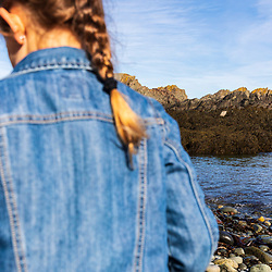A girl explores a cove in Quoddy Head State Park in Lubec, Maine.