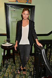 QUENTIN JONES at a Bastille Day Cocktail Party at L'Escargot, 48 Greek Street, London on 14th July 2014.