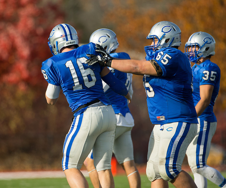 Colby College quarterback Christian Sparacio (16) and Colby College offensive lineman Drew Choos (65) the ball during a NCAA Division III football game between Colby College and Bates College at Seaverns Field at Harold Alfond Stadium on October 24, 2015 in Waterville, Maine. (Dustin Satloff)