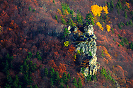 Big mountain rock among a colorful forest