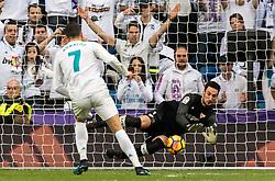 Cristiano Ronaldo dos Santos Aveiro of Real Madrid scores a penalty during the La Liga Santander match between Real Madrid CF and Sevilla FC on December 09, 2017 at the Santiago Bernabeu stadium in Madrid, Spain.