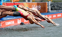England's Vicky Holland (front) dives into the water at the beginning of the Mixed Team Relay Triathlon final at the Southport Broadwater Parklands during day three of the 2018 Commonwealth Games in the Gold Coast, Australia.