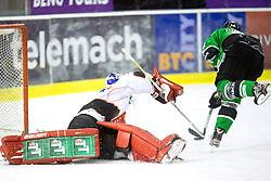 19.10.2013, Hala Tivoli, Ljubljana, SLO, EBEL, AUT, EBEL, HDD Telemach Olimpija Ljubljana vs HC TWK Innsbruck, 24. Runde, im Bild Matej Hocevar (HDD Telemach Olimpija, #14) scores againth Adam Munro (HC TWK Innsbruck Die Haie, #51) // during the Erthe Bank Icehockey League 24 th round match between HDD Telemach Olimpija Ljubljana and HC TWK Innsbruck Hala Tivoli in Ljubljana, Slovenia on 2013/10/19. EXPA Pictures © 2013, PhotoCredit: EXPA/ Sportida/ Matic Klansek Velej<br /> <br /> *****ATTENTION - OUT of SLO*****