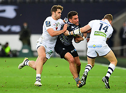 Ospreys' Kieron Fonotia is tackled by Clermont Auvergne's Damian Penaud and David Strettle - Mandatory by-line: Craig Thomas/JMP - 15/10/2017 - RUGBY - Liberty Stadium - Swansea, Wales - Ospreys Rugby v Clermont Auvergne - European Rugby Champions Cup