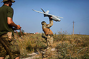 'Master' is about to launch an unmanned surveillance aircraft, (drone) being used by his team in collaboration with the Ukrainian army and patriotic volunteers' groups, to collect visual information over pro-Russia separatists' positions, in an undisclosed location near the village of Berdyans'ke, 2 km from the frontline town Shyrokine, southeast Ukraine.