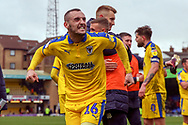 AFC Wimbledon midfielder Dylan Connolly (16) celebrating win during the EFL Sky Bet League 1 match between Southend United and AFC Wimbledon at Roots Hall, Southend, England on 16 March 2019.