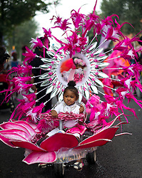 © Licensed to London News Pictures. 30/08/2015. London, UK. Family day at the Notting Hill Carnival in West London. The annual event, dating back to 1966, is one of the world's largest street festivals, attracting over one million people. Photo credit: Ben Cawthra/LNP