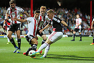 Nottingham Forest midfielder Ben Osborn (11)  with shot during the EFL Sky Bet Championship match between Brentford and Nottingham Forest at Griffin Park, London, England on 16 August 2016. Photo by Matthew Redman.