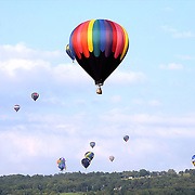 Hot air balloons fill the sky headed toward East hill during the August 30, 2013 launch from the Dansville airport during the New York State Festival of Balloons.