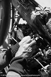 Shinya Kimura working on his Team 80 1915 Indian Twin during stage 11 (289 miles) of the Motorcycle Cannonball Cross-Country Endurance Run, which on this day ran from Grand Junction, CO to Springville, UT., USA. Tuesday, September 16, 2014.  Photography ©2014 Michael Lichter.