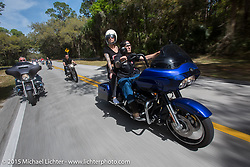 Amy And Jacob Cutler of Spencer MA on their Harley-Davidson Road Glide riding through Tamoka State Park during Daytona Beach Bike Week  2015. FL, USA. Friday, March 13, 2015.  Photography ©2015 Michael Lichter.