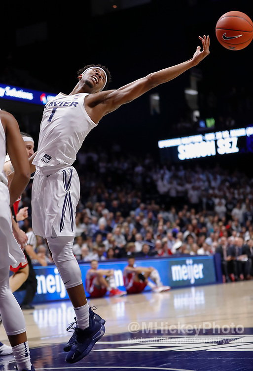 CINCINNATI, OH - NOVEMBER 13: Paul Scruggs #1 of the Xavier Musketeers reaches for a rebound during the game against the Wisconsin Badgers at Cintas Center on November 13, 2018 in Cincinnati, Ohio. (Photo by Michael Hickey/Getty Images) *** Local Caption *** Paul Scruggs