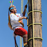 One of the performers climbs to the top of a tall pole as part of recreating a traditional Mayan ceremony of swinging from a tall pole suspended only by ropes at Xcarat Maya theme park south of Cancun and Playa del Carmen on Mexico's Yucatana Peninsula.
