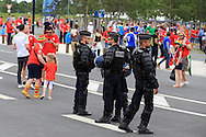 police watch Wales fans outside the stadium before k/o. Euro 2016, Wales v Slovakia at Matmut Atlantique , Nouveau Stade de Bordeaux  in Bordeaux, France on Saturday 11th June 2016, pic by  Andrew Orchard, Andrew Orchard sports photography.