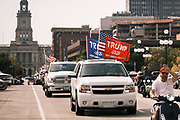 26 SEPTEMBER 2020 - DES MOINES, IOWA: A motorcade supporting the reelection of President Donald J. Trump crosses the Court Avenue Bridge in downtown Des Moines. The historic Polk County Courthouse is in the background. More than 1,500 people in 500 vehicles participated in motorcade through Des Moines Saturday. They started in the suburbs south of downtown, drove through downtown, and ended at the State Capitol.       PHOTO BY JACK KURTZ