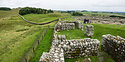 Begun around AD 124 and occupied for 280 years, Housesteads Roman Fort (Vercovicium) is the best preserved fort along Hadrian's Wall. Find it near Bardon Mill, Northumberland, England, United Kingdom, Europe. As the Roman Empire's largest artifact, Hadrian's Wall runs 117.5 kilometres (73.0 miles) across northern England from the banks of River Tyne near the North Sea to Solway Firth on the Irish Sea. Much of the wall still stands and can be walked along the adjoining Hadrian's Wall Path. Within the Roman province of Britannia, it defended the northwest frontier of the Roman Empire for nearly 300 years. It was built by the Roman army on the orders of the emperor Hadrian in the 6 years following his visit to Britain in AD 122. Hadrian's Wall is honored as a World Heritage Site. The wall lies entirely within England, and is unrelated to the Scottish border, which lies north of the wall at distances varying from 1-109 kilometers (0.6-68 miles) away. This image was stitched from multiple overlapping photos.
