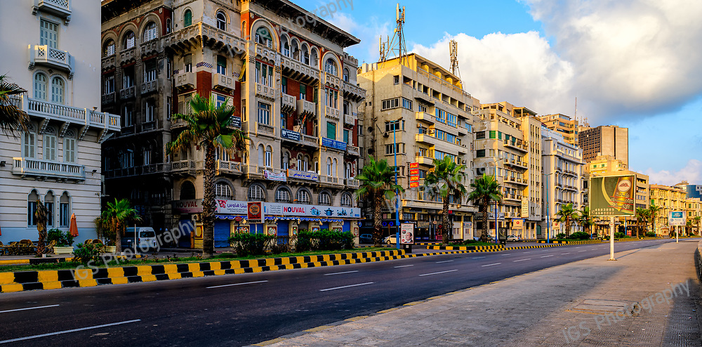 Colorful appartment buildings lining the Corniche in the old town of Alexandria, Egypt