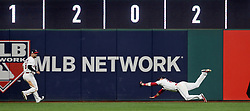 October 5, 2017 - Cleveland, OH, UKR - Cleveland Indians center fielder Jason Kipnis, right, makes a diving catch on a fly ball hit by the New York Yankees' Chase Headley in the third inning in Game 1 of the American League Division Series on Thursday, Oct. 5, 2017, at Progressive Field in Cleveland. (Credit Image: © Phil Masturzo/TNS via ZUMA Wire)