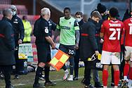 Paul Kalambayi of AFC Wimbledon leaves the field injured during the EFL Sky Bet League 1 match between Crewe Alexandra and AFC Wimbledon at Alexandra Stadium, Crewe, England on 23 January 2021.
